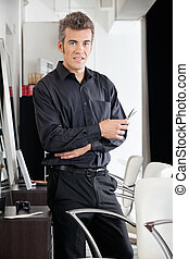 Male Hairstylist With Scissors At Salon - Portrait of mature...