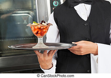 Waitress With Dessert Tray - Midsection of waitress holding...