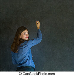 Woman writing on dark blackboard background - Confident...