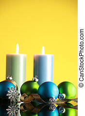Christmas decorations on yellow background,focus on blue...