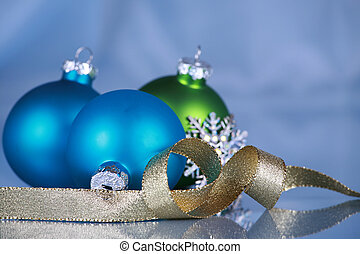 Christmas ornaments on blue cloth background