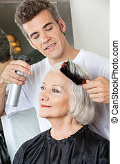 Hairdresser Setting Up Client's Hair - Hairdresser with...