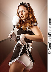 sexy French Maid holding duster - Beautiful caucasian woman...