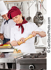 Female Chef Seasoning Salmon Roll - Female chef seasoning...