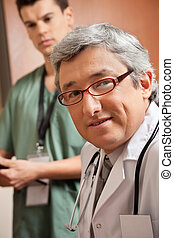 Mature Male Doctor - Portrait of mature doctor with male...