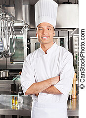 Young Chef With Arms Crossed - Portrait of young male chef...