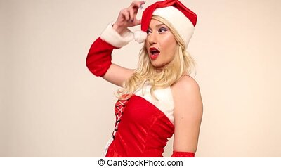 Santa girl poses and winks