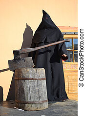 Executioner of the death penalty with a huge ax in...