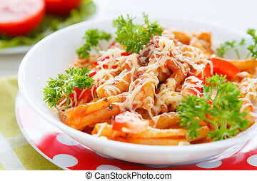 pasta with vegetables and grated cheese with tomato sauce