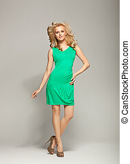 Smiling blonde cutie wearing spring collection - Smiling...