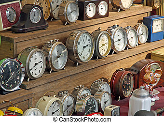 antique vintage alarm clocks and watches for sale at flea market