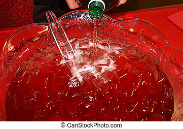 Pouring Ale Into Christmas Punch Bowl - Pouring ginger ale...