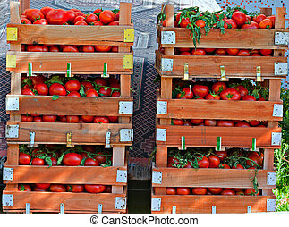 Crates of fresh tomatoes at street market - Crates of fresh...