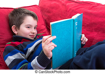 Enjoy Reading - Kid enjoy reading the novel on the...