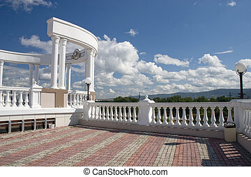 Arch with white columns and balustrade. - Arch with white...