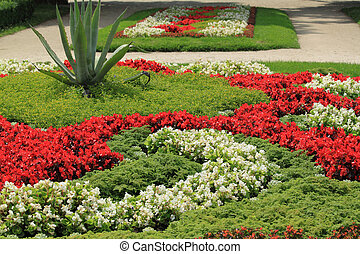 Flowerbed - Multicolored flowerbed on a lawn. horizontal...