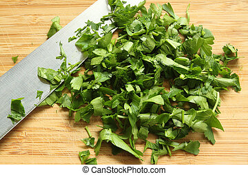 Chopped green parsley on a chopping board