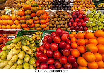 Exotic Fruits in a Market - Exotic colorful fruits in a...