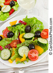 salad with fresh vegetables on the plate