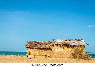 Mud Hut on a Beach - A mud house, typical housing of Wayuu...