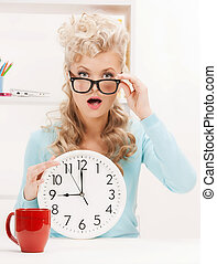 wondering businesswoman with clock - picture of young...