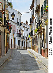 Sunny street of Spanish city Granada - The narrow street is...