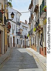 Sunny street of Spanish city Granada - The narrow street is...