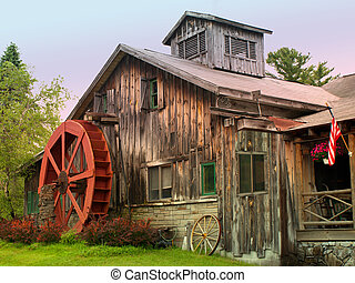 watermill house - rural rustic home with a waterwheel