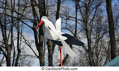 toy stork decor rotate - toy stork on the shaft with wooden...