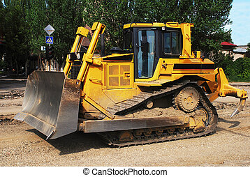 Yellow Bulldozer at Road Construction Site