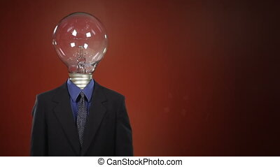 Light Bulb Head - A man in a suit with a light bulb in place...