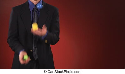 Man in Suit Juggling