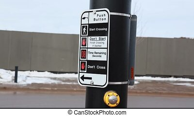 pedestrian crosswalk button to safely cross a busy street