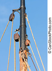 Mast and rigging from old wooden sailing ship
