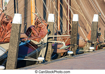 Old historic sailing ships in Dutch harbor of Urk