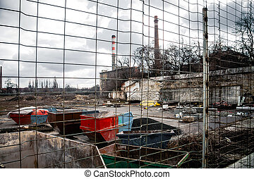 Industrial waste dump outdoors protected with fence