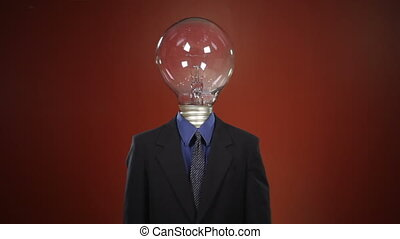 Mr. Brilliant Idea - A man in a suit with a light bulb in...
