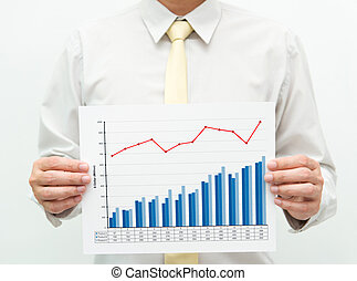 Business chart - Man holding a business financial graph and...