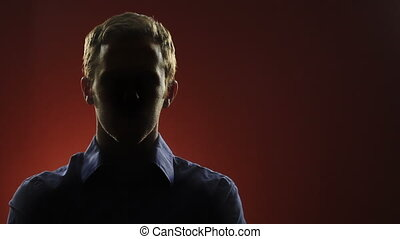 Mystery Man - A businessman, whose face is hidden in shadow,...