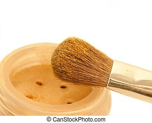 gold make-up eyeshadows and cosmetic brush