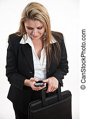 Pretty hispanic blond businesswoman in suit with phone