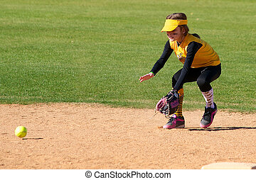 Softball Player Fielding a Ground Ball from the shortstop...
