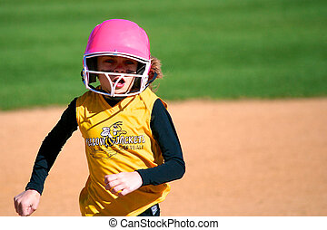 Softball Player Running to Third Base