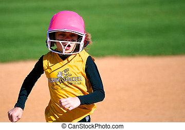 Softball Player Running to Third Base