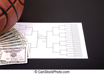 March Madness Bracket Basketball and Fanned Money on Black -...