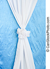 white curtains ribbon on blue background