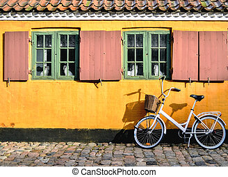 Bicycle in front of the entrance to an apartment in one of...