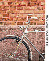 Bicycle against brick wall detail