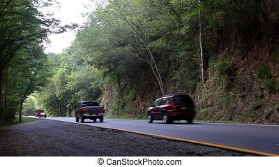Mountain Road - Cars driving on a forest road in the Smokey...