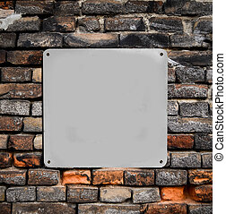 Empty metal sign on brick wall